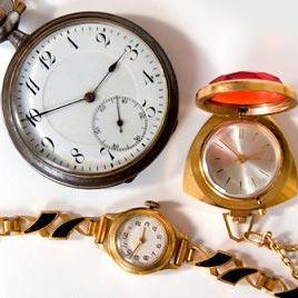 een horloge - часовник